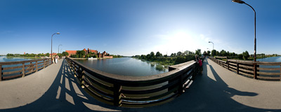 Malbork - the wooden bridge over the Nogat river leads to the castle.  Click to view this panorama in new fullscreen window