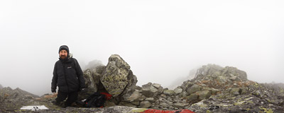 In the clouds on the rocky summit of Mięguszowiecki Szczyt Czarny (Východný Mengusovský štít, 2410 m) in the Tatra Mountains.  Click to view this panorama in new fullscreen window