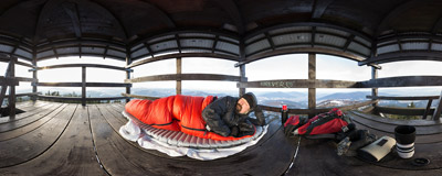 Lazing on a sunny morning on the wooden viewing tower on the summit of Mogielica (1170 m).  Click to view this panorama in new fullscreen window