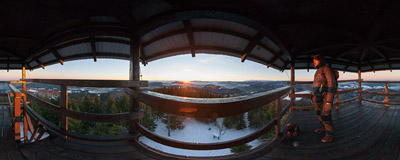 A late December sunrise watched from a wooden viewing tower on the summit of Mogielica (1170 m) in the Beskid Wyspowy mountain range.  Click to view this panorama in new fullscreen window