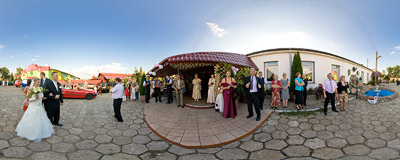 My cousin's wedding in Ninków: the married couple is being welcome with bread and salt.  Click to view this panorama in new fullscreen window