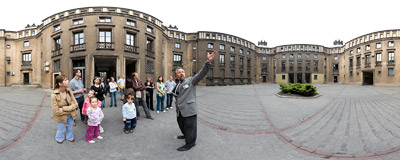 Mr Maciej Miezian from the Historical Museum of Kraków showing the Renaissance-inspired architecture of the former Lenin Steelworks (now part of ArcelorMittal).  Click to view this panorama in new fullscreen window