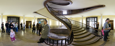 "Mr Maciej Miezian from the Historical Museum of Kraków showing ""the most beautiful stairwell in Kraków"", built in 1940s in the office building of the former Lenin Steelworks.  Click to view this panorama in new fullscreen window"