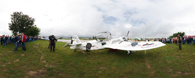 Sukhoi Su-31 aerobatic plane, just flown in to the air show in Kraków by Jurgis Kairys, the Lithuanian champion who can be seen giving an interview to a TV reporter.  Click to view this panorama in new fullscreen window