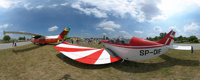 Air Show in Kraków: PZL M26 Iskierka plane.  Click to view this panorama in new fullscreen window