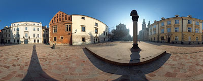 Kraków - St. Mary Magdalen Square with Piotr Skarga's statue and St. Peter & St. Paul's  and St. Andrew's churches in the background.  Click to view this panorama in new fullscreen window