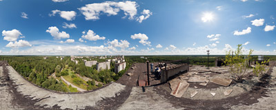 On the roof of a 16-story apartment block (sometimes nicknamed Fujiyama) in Pripyat, Ukraine, with the former Chernobyl nuclear power plant visible in the distance.  Click to view this panorama in new fullscreen window