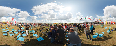 Radom Air Show 2009: just after the crash of the Belarussian Su-27 everyone in the media sector is listening to the communication between the control tower and rescue services.  Click to view this panorama in new fullscreen window
