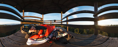 A lazy morning half an hour after sunrise on a wooden viewing tower on Radziejowa (1262 m), the highest summit of the Beskid Sądecki mountain range.  Click to view this panorama in new fullscreen window