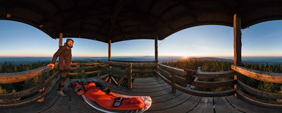 Watching the sunset from a wooden viewing tower on Radziejowa (1262 m), the highest summit of the Beskid Sądecki mountain range.  Click to view this panorama in new fullscreen window