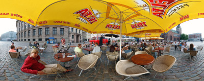 During the summer season the Cathedral Square (Doma laukums) in Riga is occupied with bustling beer gardens while bands of all sorts provide some entertainment; right now it's the Mitrokhin Master Band guitar duet.  Click to view this panorama in new fullscreen window