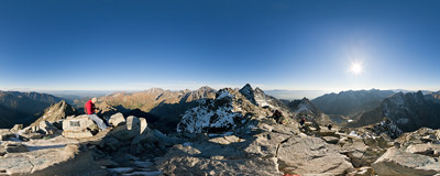 Late autumn afternoon on the summit of Rysy (2499 m) on the Polish-Slovak border in Tatra mountains.  Click to view this panorama in new fullscreen window