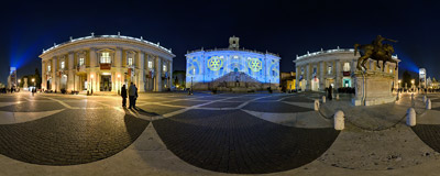 The facade of the Senatorial Palace in Piazza del Campidoglio in Rome lit up with the symbols of Rotary International and its End Polio Now campaign.  Click to view this panorama in new fullscreen window