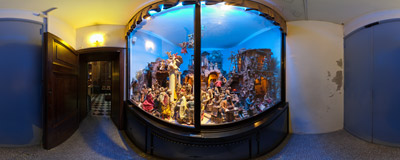 A traditional nativity scene (il presepio) in the church of Santa Maria in Via on Via del Mortaro in Rome, Italy.  Click to view this panorama in new fullscreen window
