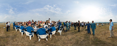 Pilots from the Frecce Tricolori aerobatic team signing autographs during the SIAF 2012 air show in Sliač, Slovakia.  Click to view this panorama in new fullscreen window