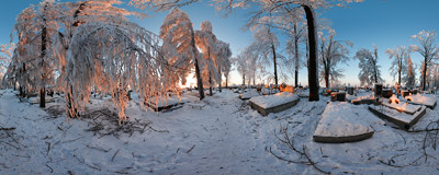 The cemetery in Skała with rime-covered trees reflecting the orange glow of sunset.  Click to view this panorama in new fullscreen window