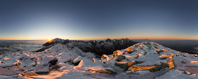 Late-autumn sunset on the summit of Slavkovský štít (2452 m) in Slovak High Tatras.  Click to view this panorama in new fullscreen window