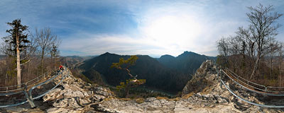 On the top of Sokolica (747 m) with Dunajec river down below, Tatra mountains in the distance.  Click to view this panorama in new fullscreen window