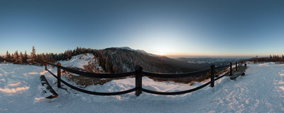 Sokolica (1367 m) near Babia Góra in the Beskidy Mountains with the sun setting behind Cyl (1517 m).  Click to view this panorama in new fullscreen window