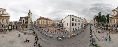 The peloton of the 69th Tour de Pologne cycling race passing through the streets of Kraków's Old Town.  Click to view this panorama in new fullscreen window