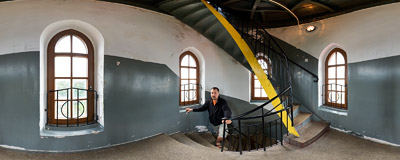 Steep stairs are going up to the top of a lighthouse in Ustka.  Click to view this panorama in new fullscreen window