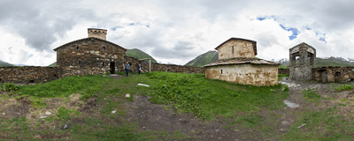 A tiny two-monk monastery with the 12th-century church of the Virgin Mary (Lamaria) on a hill above the Ushguli village in Svaneti, Georgia.  Click to view this panorama in new fullscreen window