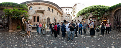 The crowded courtyard of the Casa di Giulietta, the Juliet's House, in Verona, Italy.  Click to view this panorama in new fullscreen window