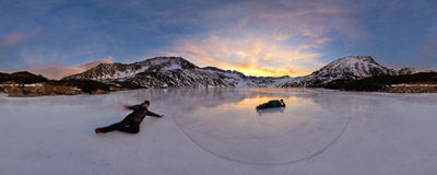 A beautiful sunset on the frozen lake in the Dolina Pięciu Stawów Polskich ('Valley of Five Polish Lakes') in the Tatra Mountains.  Click to view this panorama in new fullscreen window