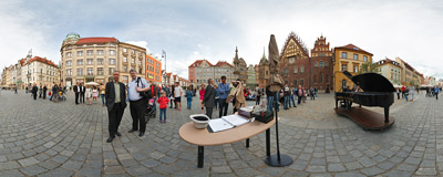 Arne Schmitt, a German street musician performing on his piano on the Market Square in Wrocław.  Click to view this panorama in new fullscreen window