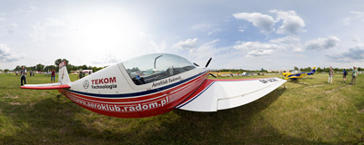 10th Air Show in Kraków-Czyżyny: Robert Kowalik's Extra 300L aerobatic plane.  Click to view this panorama in new fullscreen window