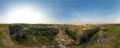 Flying above the edge of an abandoned limestone quarry in Zakrzówek, Kraków.  Click to view this panorama in new fullscreen window